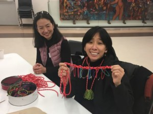 "Following only a simple prompt, ""String it!,"" this educator created a unique jewelry design out of the materials at her table during Tandem's break-out session."